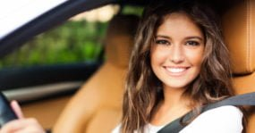 young girl in seat belt